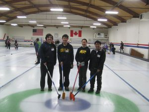 4 curlers standing together